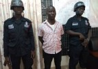 Spokesman for youth vigilante group that invaded TTH in the firm grips of police